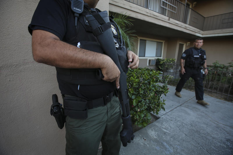 ICE agents carry out a raid to apprehend undocumented immigrants in Riverside, California, last year. (Irfan Khan/Los Angeles Times via Getty Images)