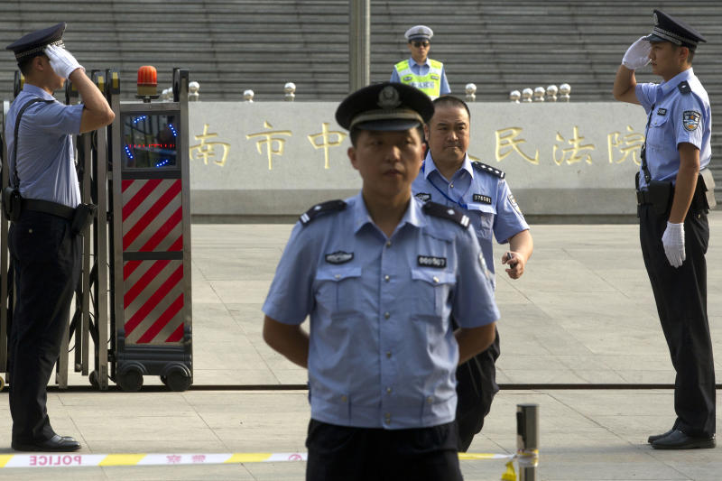 Chinese police officers stand on duty outside the Jinan Intermediate People's Court in Jinan in eastern China's Shandong province on Sunday, Aug. 25, 2013. Former Chinese politician Bo Xilai's trial on charges of bribery, embezzlement and abuse of power goes on for a fourth day. (AP Photo/Ng Han Guan)