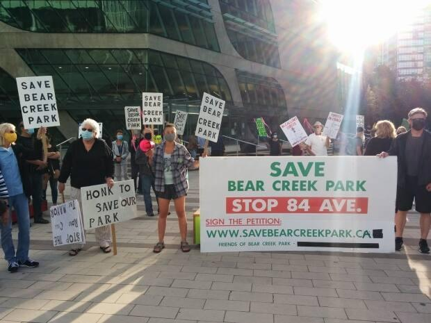 Protesters fighting the expansion of a road through Bear Creek Park in Surrey, B.C., gather outside city hall on May 31, 2021. (Facebook/Friends of Bear Creek Park - image credit)