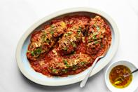 """For a late-summer dinner with some ceremony, stuff cored eggplants with spiced ground lamb and steam them whole in an oniony tomato sauce. Top with <a href=""""https://www.epicurious.com/expert-advice/when-garlics-the-garnish-adha-article?mbid=synd_yahoo_rss"""" rel=""""nofollow noopener"""" target=""""_blank"""" data-ylk=""""slk:crispy garlic"""" class=""""link rapid-noclick-resp"""">crispy garlic</a>, herbs, and yogurt, and rest easy knowing you've made the most of the weekend's best produce. <a href=""""https://www.epicurious.com/recipes/food/views/stuffed-eggplants-and-zucchini-tomato-sauce-falastin?mbid=synd_yahoo_rss"""" rel=""""nofollow noopener"""" target=""""_blank"""" data-ylk=""""slk:See recipe."""" class=""""link rapid-noclick-resp"""">See recipe.</a>"""