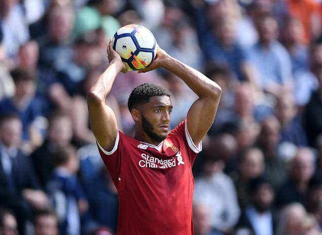 Joe Gomez preparing to take a throw-in (Photo by Laurence Griffiths/Getty Images)