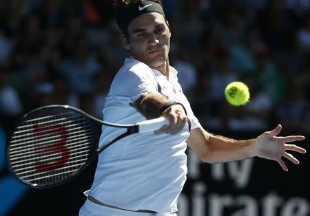 Tennis - Australian Open - Rod Laver Arena, Melbourne, Australia, January 22, 2018. Roger Federer of Switzerland hits a shot against Marton Fucsovics of Hungary. REUTERS/Thomas Peter