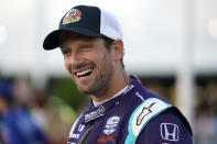 FILE - Romain Grosjean (51) smiles before the start an IndyCar auto race at World Wide Technology Raceway on Saturday, Aug. 21, 2021, in Madison, Ill. Grosjean will move to Andretti Autosport next season and drive the full 17-race schedule, including the Indianapolis 500. The Frenchman has fallen in love with IndyCar since moving to the series this season from Formula One. (AP Photo/Jeff Roberson, File)