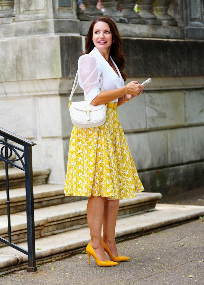 <p>Davis stepped out in a coordinated white-yellow ensemble featuring Anne Fontaine's Candide transparent mesh shirt and a Zac Posen floral-print skirt. She accessorized with a matching white Dior bag and yellow Manolo Blahnik BB pumps.</p>