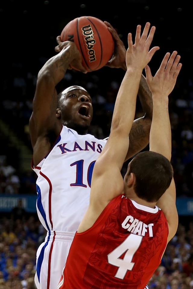 NEW ORLEANS, LA - MARCH 31:  Tyshawn Taylor #10 of the Kansas Jayhawks shoots the ball over Aaron Craft #4 of the Ohio State Buckeyes in the first half during the National Semifinal game of the 2012 NCAA Division I Men's Basketball Championship at the Mercedes-Benz Superdome on March 31, 2012 in New Orleans, Louisiana.  (Photo by Chris Graythen/Getty Images)