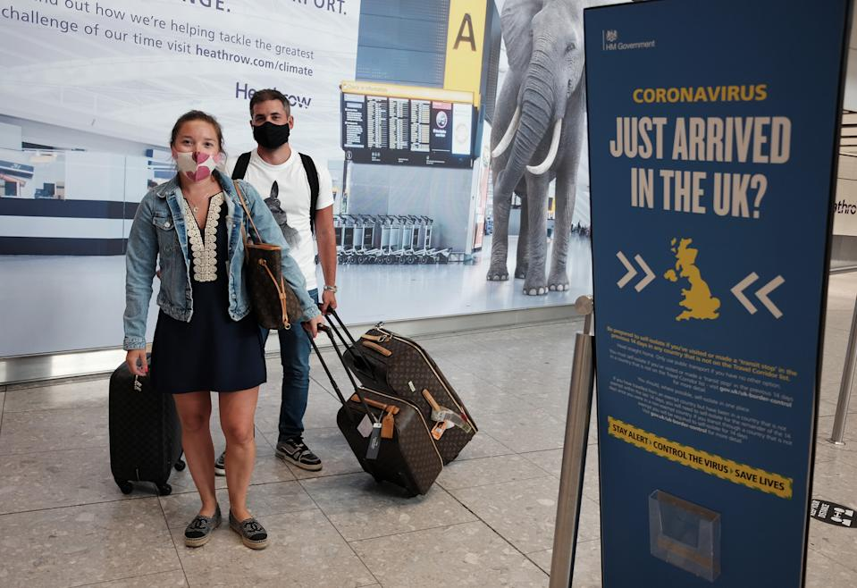 Passengers Charlotte, 29, and Frank, 30, Piazza arrive at Heathrow Airport as they return from Mykonos in Greece, after the Government added the islands of Lesvos, Tinos, Serifos, Mykonos, Crete, Santorini and Zakynthos, also known as Zante to the quarantine list. From 4am on Wednesday, arrivals from the seven Greek islands will need to self-isolate for 14 days - but mainland Greece will maintain its quarantine-exemption.