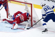 Montreal Canadiens goaltender Carey Price, left, makes a save off Tampa Bay Lightning's Nikita Kucherov during the second period of Game 3 of the NHL hockey Stanley Cup Final, Friday, July 2, 2021, in Montreal. (Paul Chiasson/The Canadian Press via AP)