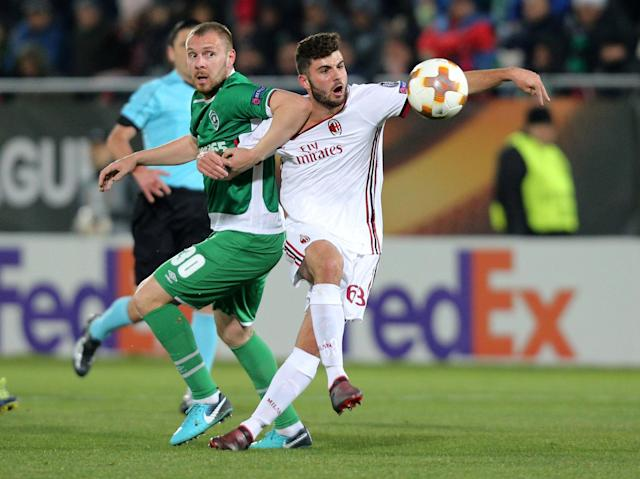 Soccer Football - Europa League Round of 32 First Leg - PFC Ludogorets Razgrad vs AC Milan - Ludogorets Arena, Razgrad, Bulgaria - February 15, 2018 AC Milan's Patrick Cutrone in action with Ludogorets' Cosmin Moti REUTERS/Stoyan Nenov