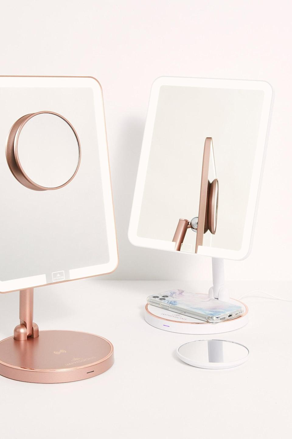 """<p>A beauty-lover will enjoy this <a href=""""https://www.popsugar.com/buy/Royale-Makeup-Mirror-amp-Wireless-Charger-527145?p_name=Royale%20Makeup%20Mirror%20%26amp%3B%20Wireless%20Charger&retailer=freepeople.com&pid=527145&price=99&evar1=fab%3Aus&evar9=45460327&evar98=https%3A%2F%2Fwww.popsugar.com%2Ffashion%2Fphoto-gallery%2F45460327%2Fimage%2F46977995%2FRoyale-Makeup-Mirror-Wireless-Charger&list1=shopping%2Cgifts%2Cfree%20people%2Choliday%2Cgift%20guide%2Cgifts%20for%20women&prop13=api&pdata=1"""" class=""""link rapid-noclick-resp"""" rel=""""nofollow noopener"""" target=""""_blank"""" data-ylk=""""slk:Royale Makeup Mirror & Wireless Charger"""">Royale Makeup Mirror & Wireless Charger</a> ($99).</p>"""
