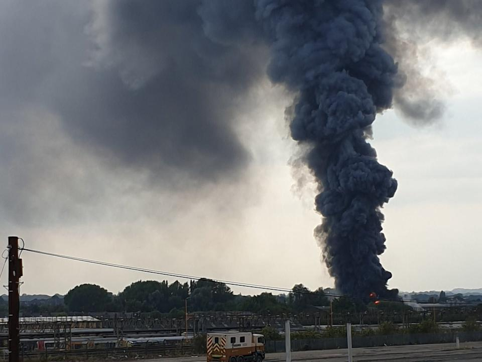 The plume of smoke could be seen a long way away: PA