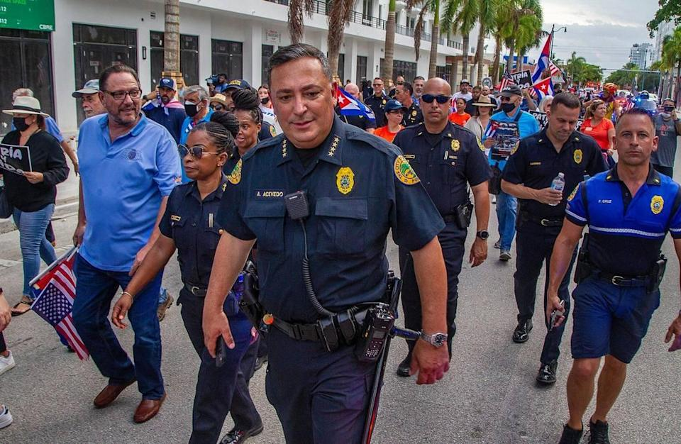 City of Miami Police officers, including Chief Art Acevedo, joined Cuban exiles on a march called by the Kiwanis Club of Little Havana along Southwest Eighth Street to the Bay of Pigs Heroes Monument to show solidarity and support for the Cuban people asking for freedom and the end of 62 years of an oppressive authoritarian regime on the island, on Friday July 23, 2021.