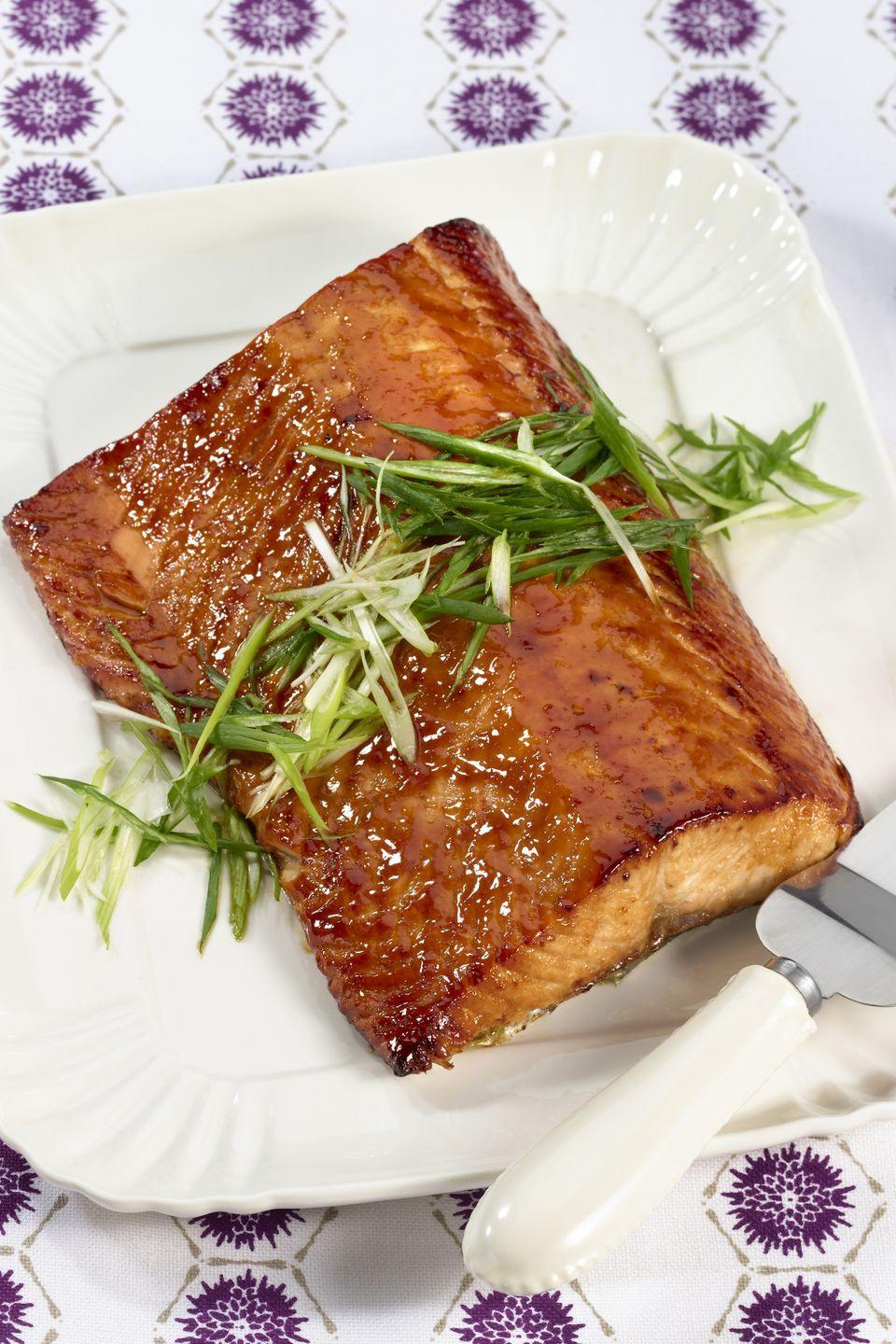 """<p>Sweet and salty flavors combine to glaze this melt-in-your-mouth salmon fillet. </p><p><strong><a href=""""https://www.countryliving.com/food-drinks/recipes/a1889/pineapple-soy-glazed-salmon-4059/"""" rel=""""nofollow noopener"""" target=""""_blank"""" data-ylk=""""slk:Get the recipe"""" class=""""link rapid-noclick-resp"""">Get the recipe</a>.</strong></p>"""