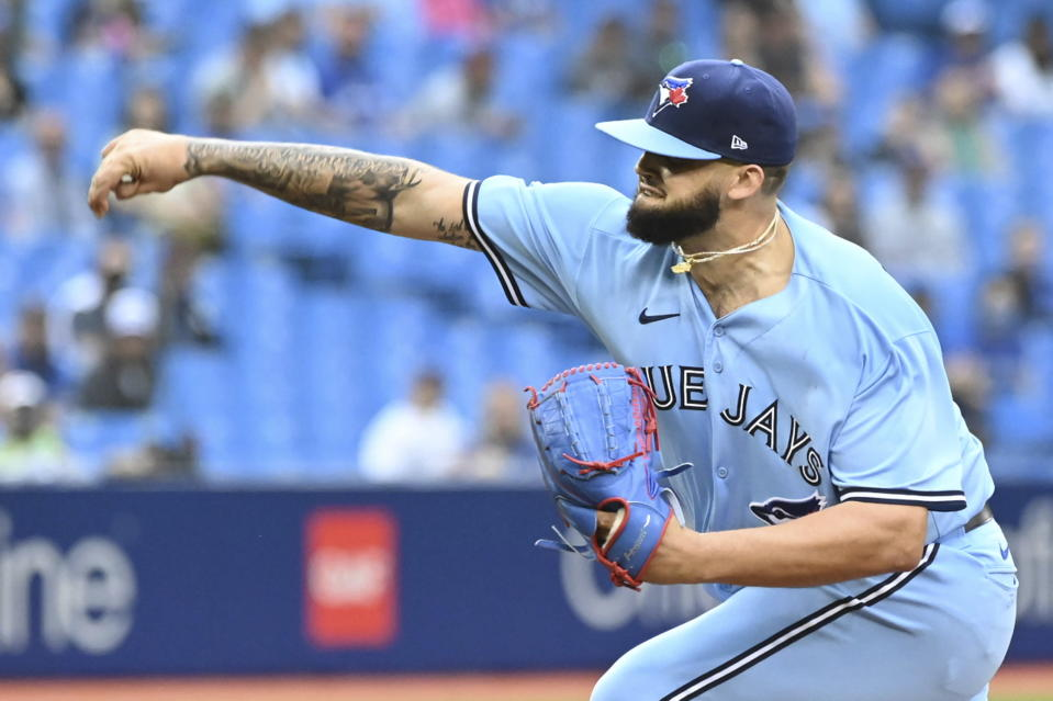 Toronto Blue Jays' Alek Manoha pitches during the first inning in MLB baseball action against the Kansas City Royals in Toronto on Saturday, July 31, 2021. (Jon Blacker/The Canadian Press via AP)
