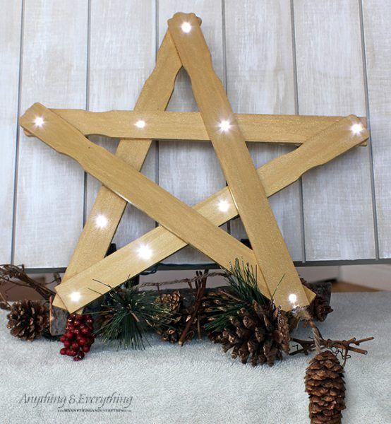 """<p>Use paint-stirring sticks and a string of clear lights to craft the sweetest star-shaped tree topper ever. (Make simpler, smaller versions with popsicle sticks for hanging in windows or from a mantle.)</p><p><em><a href=""""https://thenymelrosefamily.com/diy-christmas-decorations/"""" rel=""""nofollow noopener"""" target=""""_blank"""" data-ylk=""""slk:Get the tutorial at The Melrose Family"""" class=""""link rapid-noclick-resp"""">Get the tutorial at The Melrose Family</a></em><br></p>"""