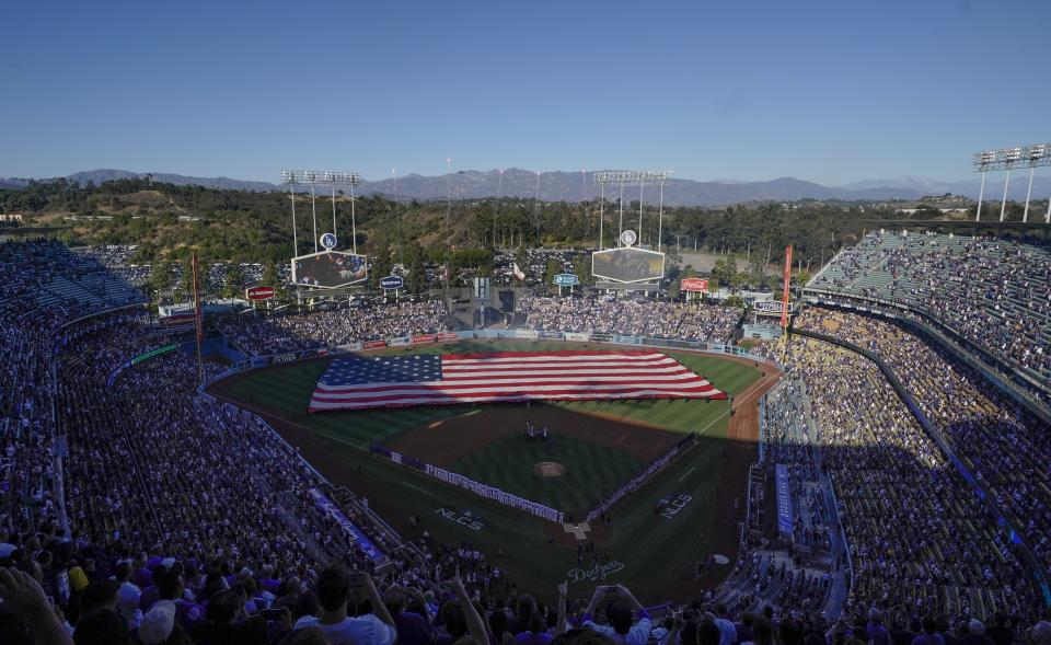 Players line up at Dodger Stadium before Game 3 of the National League Championship Series baseball game between the Milwaukee Brewers and the Los Angeles Dodgers Monday, Oct. 15, 2018, in Los Angeles. (AP Photo/Tim Donnelly)