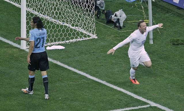 England's Wayne Rooney, right, runs past Uruguay's Edinson Cavani, left, as he celebrates scoring his side's first goal during the group D World Cup soccer match between Uruguay and England at the Itaquerao Stadium in Sao Paulo, Brazil, Thursday, June 19, 2014. (AP Photo/Michael Sohn)
