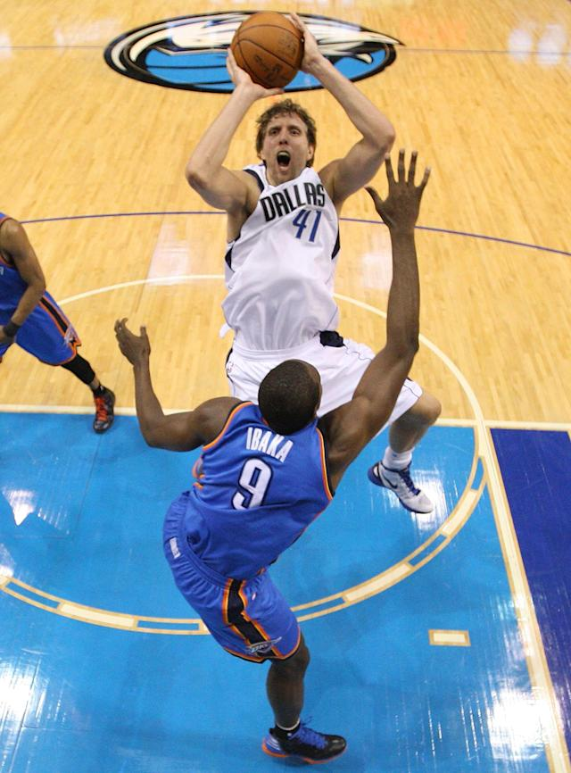 DALLAS, TX - MAY 05: Dirk Nowitzki #41 of the Dallas Mavericks takes a shot against Serge Ibaka #9 of the Oklahoma City Thunder during Game Four of the Western Conference Quarterfinals in the 2012 NBA Playoffs at American Airlines Center on May 5, 2012 in Dallas, Texas. NOTE TO USER: User expressly acknowledges and agrees that, by downloading and or using this photograph, User is consenting to the terms and conditions of the Getty Images License Agreement. (Photo by Ronald Martinez/Getty Images)