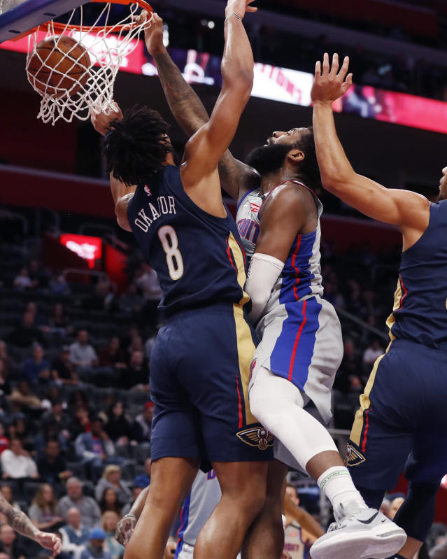 Detroit Pistons center Andre Drummond, center, dunks on New Orleans Pelicans center Jahlil Okafor (8) during the first half of an NBA basketball game, Monday, Jan. 13, 2020, in Detroit. (AP Photo/Carlos Osorio)