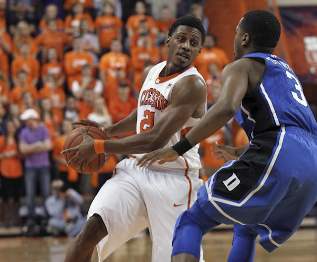 Clemson's Demarcus Harrison, left, holds the ball as Duke's Tyler Thorton defends during an NCAA college basketball game Saturday, Jan. 11, 2014, in Clemson, S.C. (AP Photo/Anderson Independent-Mail, Mark Crammer)
