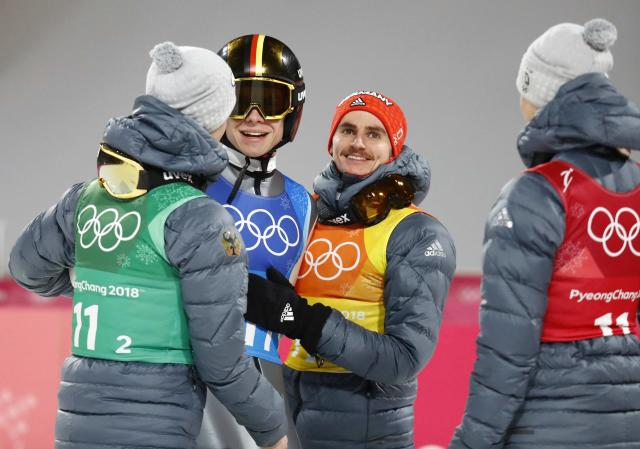 Ski Jumping - Pyeongchang 2018 Winter Olympics - Men's Team Final - Alpensia Ski Jumping Centre - Pyeongchang, South Korea - February 19, 2018 - Andreas Wellinger of Germany greets team mates Karl Geiger, Stephan Leyhe and Richard Freitag after his jump. REUTERS/Dominic Ebenbichler