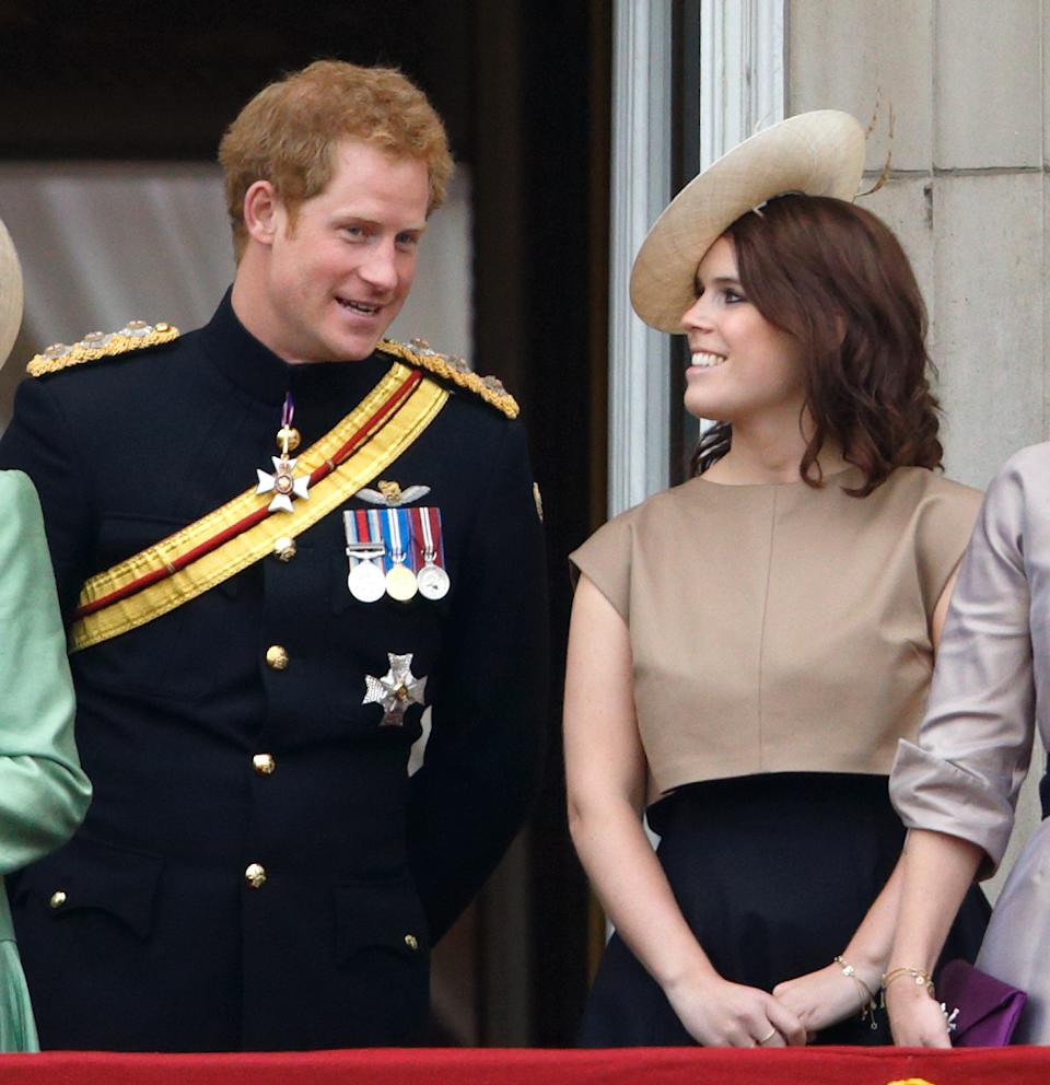 LONDON, UNITED KINGDOM - JUNE 13: (EMBARGOED FOR PUBLICATION IN UK NEWSPAPERS UNTIL 48 HOURS AFTER CREATE DATE AND TIME) Prince Harry and Princess Eugenie stand on the balcony of Buckingham Palace during Trooping the Colour on June 13, 2015 in London, England. The ceremony is Queen Elizabeth II's annual birthday parade and dates back to the time of Charles II in the 17th Century, when the Colours of a regiment were used as a rallying point in battle. (Photo by Max Mumby/Indigo/Getty Images)