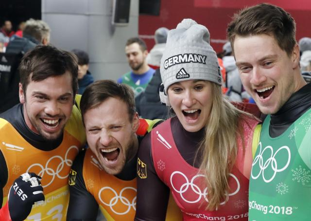 Luge - Pyeongchang 2018 Winter Olympic Games - Team Relay - Pyeongchang, South Korea - February 15, 2018 - Gold medalists Natalie Geisenberger, Johannes Ludwig, Tobias Wendl and Tobias Arlt of Germany celebrate. REUTERS/Arnd Wiegmann