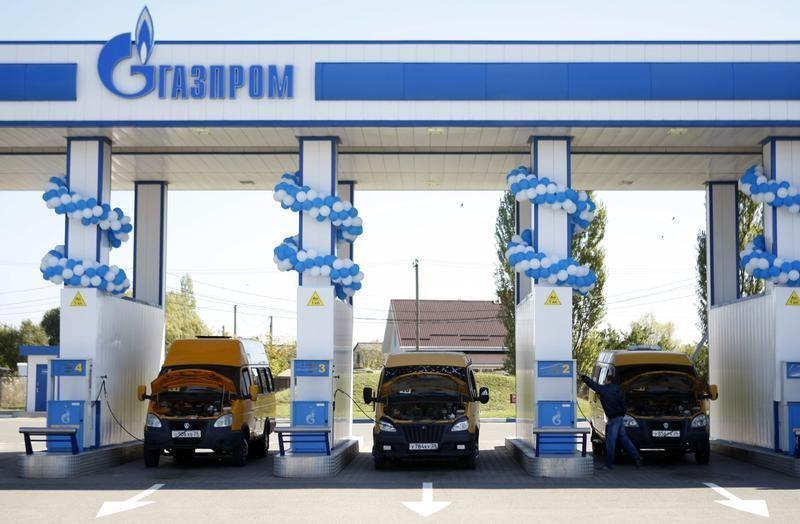 Vehicles are seen at a gas filling station, owned by Gazprom Transgaz Stavropol, with the company logo of Russian natural gas producer Gazprom seen on the station, in Stavropol in southern Russia