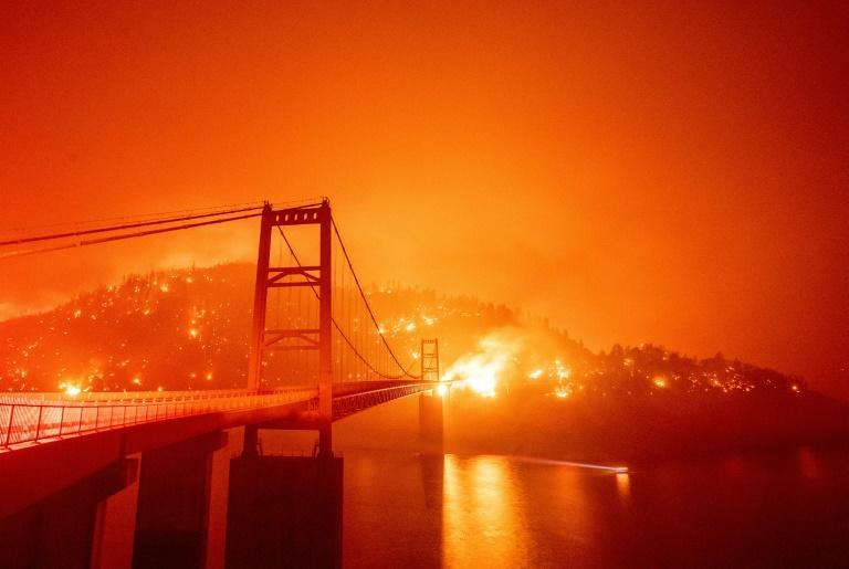 """""""The road over the Bidwell Bar Bridge seemed to run straight into the heart of the flames,"""" AFP photographer Josh Edelson said (AFP/JOSH EDELSON)"""