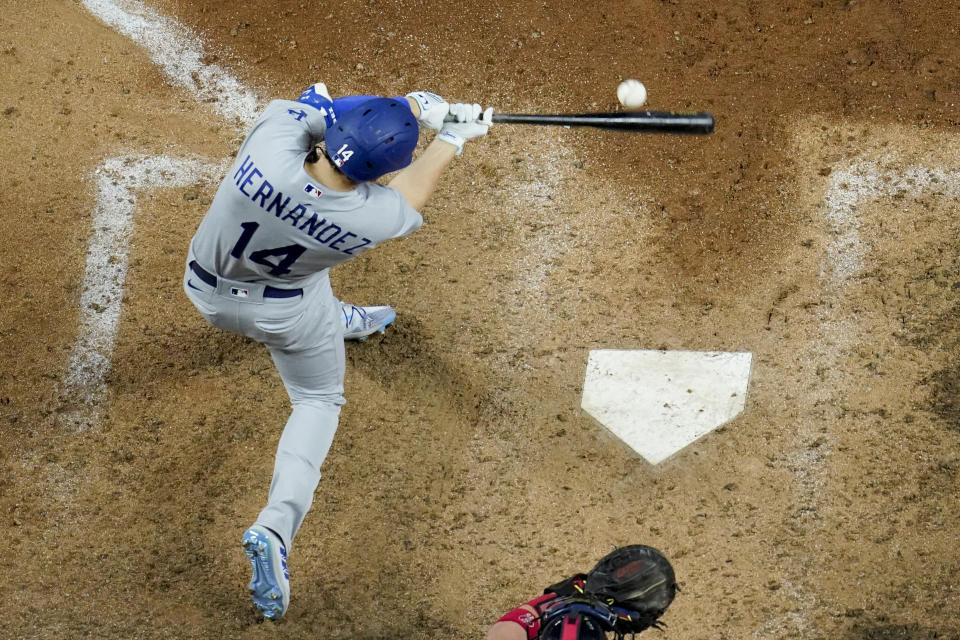 Los Angeles Dodgers' Enrique Hernandez hits a single against the Atlanta Braves in Game 3 of the NLCS. (AP Photo/David J. Phillip)