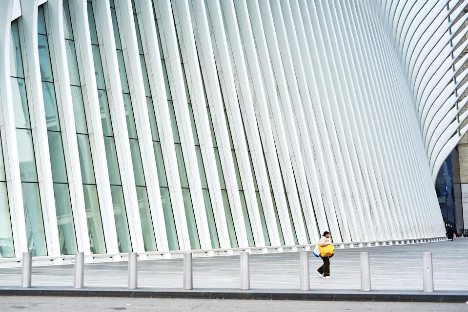 A pedestrian walks past the Oculus in the Financial District on Monday, March 30. The World Trade Center's transit hub typically gets up to 120 million visitors every year.