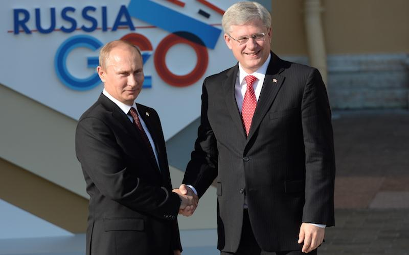 """This photo shows Russian President Vladimir Putin, left, and former Canadian prime minister Stephen Harper shaking hands at the G20 summit in St. Petersburg, Russia, in September 2013. Fourteen months after this handshake, Harper reportedly told Putin to """"get out of Ukraine."""" Photo from Getty Images."""