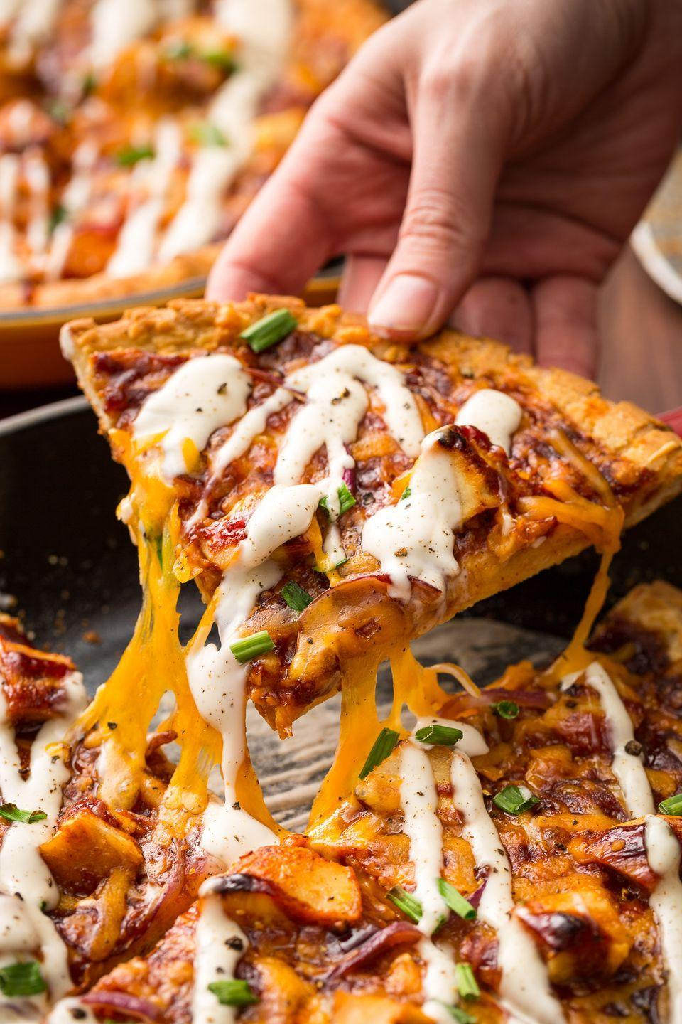 """<p>A slight differentiation of the classic and the skillet takes this dish to a whole new level. </p><p>Get the recipe from <a href=""""https://www.oprahdaily.com/cooking/recipe-ideas/recipes/a46838/bbq-chicken-skillet-pizza-recipe/"""" rel=""""nofollow noopener"""" target=""""_blank"""" data-ylk=""""slk:Delish"""" class=""""link rapid-noclick-resp"""">Delish</a>.</p>"""