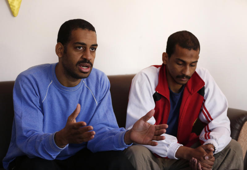 """FILE - In this March 30, 2019, file photo, Alexanda Amon Kotey, left, and El Shafee Elsheikh, who were allegedly among four British jihadis who made up a brutal Islamic State cell dubbed """"The Beatles,"""" speak during an interview with The Associated Press at a security center in Kobani, Syria, Friday, March 30, 2018. The men said that their home country's revoking of their citizenship denies them a fair trial. """"The Beatles"""" terror cell is believed to have captured, tortured and killed hostages including American, British and Japanese journalists and aid workers. (AP Photo/Hussein Malla, File)"""