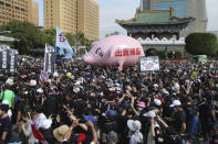 "People hold a pig model ""Betray pig farmers"" written on it during a protest in Taipei, Taiwan, Sunday, Nov. 22. 2020. Thousands of people marched in streets on Sunday demanding the reversal of a decision to allow U.S. pork imports into Taiwan, alleging food safety issues. (AP Photo/Chiang Ying-ying)"