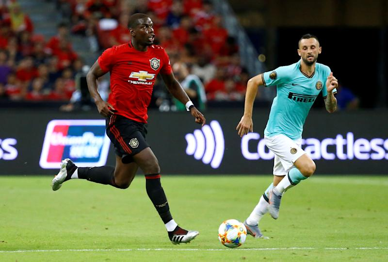 Soccer Football - International Champions Cup - Manchester United v Inter Milan - Singapore National Stadium, Singapore - July 20, 2019 Manchester United's Paul Pogba in action with Inter Milan's Marcelo Brozovic REUTERS/Feline Lim