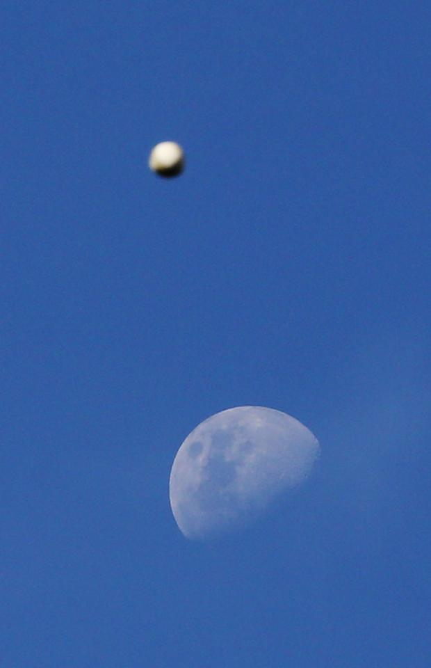 MELBOURNE, AUSTRALIA - DECEMBER 22:  A cricket ball goes past the moon during practice before the Big Bash League match between the Melborune Renegades and the Brisbane Heat at Etihad Stadium on December 22, 2012 in Melbourne, Australia.  (Photo by Michael Dodge/Getty Images)