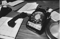 """<p>The rotary phone was <a href=""""https://www.nytimes.com/1999/10/07/technology/when-dials-were-round-and-clicks-were-plentiful.html#:~:text=Rotary%20dial%20phones%20were%20introduced,used%20until%20the%20mid%2D1950's."""" rel=""""nofollow noopener"""" target=""""_blank"""" data-ylk=""""slk:invented in 1919"""" class=""""link rapid-noclick-resp"""">invented in 1919</a> and was still dominant in the '70s. It wasn't until the '80s that the technology was improved and rotary phones began to be phased out. </p>"""