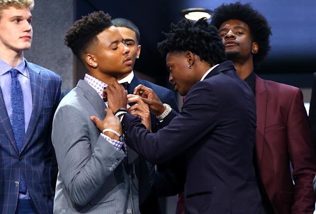 <p>De'Aaron Fox helps adjust the bowtie of Markelle Fultz before the first round of the 2017 NBA Draft at Barclays Center on June 22, 2017 in New York City. </p>