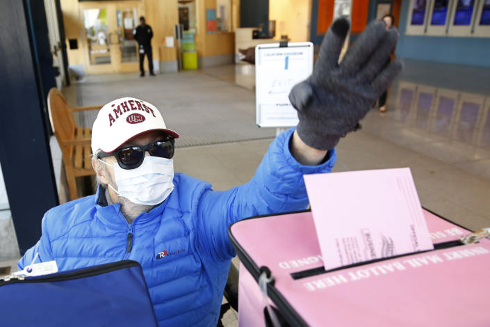 """FILE - In this Monday, March 2, 2020 file photo, a man wearing a mask as a precaution against passing or receiving germs casts his ballot on the eve of Super Tuesday, at a voting center in Sacramento, Calif. On Friday, June 19, 2020, The Associated Press reported on stories circulating online incorrectly asserting all California registered to vote as an independent will not be able to vote Republican in 2020. Information contained in the post does not apply to the general election this fall. During California's presidential primary election on March 3, independent voters, also known as """"no party preference"""" voters, could vote in the Democratic presidential primary without changing their party affiliation, but not in the Republican primary. (AP Photo/Rich Pedroncelli)"""