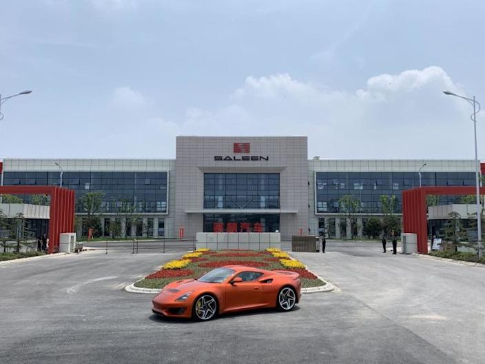 "An S1 sports car is parked at the entrance to the Jiangsu Saleen auto plant in Rugao, China. <span class=""copyright"">(Saleen Automotive Inc.)</span>"