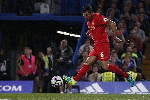 Liverpool's Dejan Lovren sets up a close-range volley to score the opening goal against Chelsea (AFP Photo/Adrian Dennis)