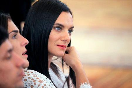 Russian pole vaulter Yelena Isinbayeva attends an awarding ceremony for Russian Olympic medallists returning home from the 2016 Rio Olympics at the Kremlin in Moscow