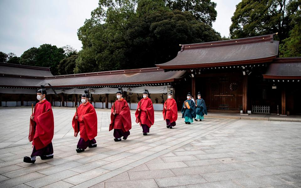 Shinto priests mark 100 years since the founding of Meiji shrine in Tokyo, Japan - Getty