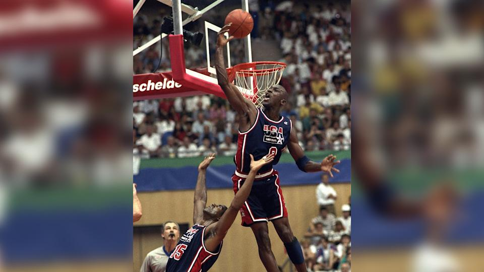 Mandatory Credit: Photo by Susan Ragan/AP/Shutterstock (7286460a)USA's Michael Jordan sails high above teammate Magic Johnson knocking away a shot during the first half of their preliminary round basketball game with Croatia at the Summer Olympics in Barcelona.