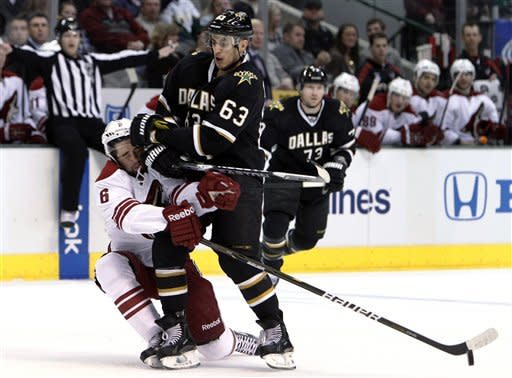 Phoenix Coyotes defenseman David Schlemko (6) intercepts a puck in a collision with Dallas Stars' Mike Ribeiro (63) in the first period of an NHL hockey game Tuesday, March 20, 2012, in Dallas. (AP Photo/Tony Gutierrez)