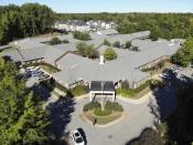 This Sept. 23, 2021 photo shows the Blumenthal Nursing and Rehabilitation Center in Greensboro, N.C. In January 2019, it had a staffing level above the benchmark used by many experts, earning four stars out of five under Medicare's staffing ratings. But it fell about 12% in the year that followed, even more in the first year of the pandemic, and still more in the months since. By June, the facility's staffing was down 15% from the start of 2020, and 25% from the start of 2019. (AP Photo/Allen G. Breed)