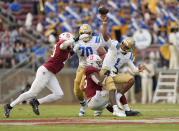 UCLA quarterback Dorian Thompson-Robinson (1) is pressured by Stanford linebacker Ricky Miezan, center, and linebacker Jordan Fox, left, during the second half of an NCAA college football game Saturday, Sept. 25, 2021, in Stanford, Calif. (AP Photo/Tony Avelar)