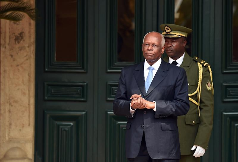 Angola's President Jose Eduardo Dos Santos waits for the arrival of his French counterpart at the presidential palace in Luanda in July 2015