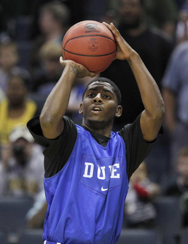 Duke's Kyrie Irving takes a shot during practice for an NCAA West regional tournament college basketball game in Charlotte, N.C., Thursday, March 17, 2011.  Duke plays Hampton on Friday. (AP Photo/Bob Leverone)
