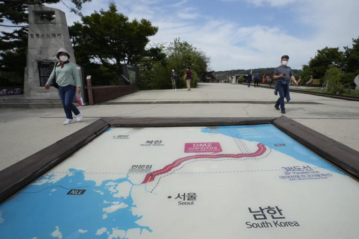 Visitors walk by a map of two Koreas showing North Korea's capital Pyongyang and South Korea's capital Seoul at the Imjingak Pavilion in Paju, near the border with North Korea, South Korea, Friday, Sept. 24, 2021. North Korean leader Kim Jong Un's powerful sister, Kim Yo Jong, said Friday, North Korea is willing to resume talks with South Korea if it doesn't provoke the North with hostile policies and double standards. (AP Photo/Ahn Young-joon)